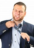 tired businessman taking off necktie