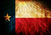 foto of texans  - Texan flag waving in the wind with some spots and stains - JPG