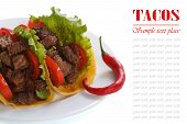 Mexican tacos with chili peppers isolated on white
