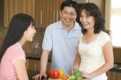 Family Laughing While Preparing Meal, Mealtime
