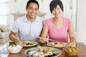 Young Couple Enjoying Chinese Food