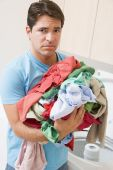 Man Upset Doing Laundry