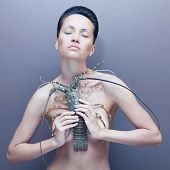 stock photo of lobster  - Surreal portrait of young unusual lady with lobster - JPG