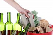 pic of discard  - Hand putting paper into recycling bin isolated background - JPG