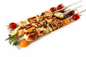fresh grilled shish kebab on white platter