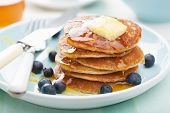 stock photo of dessert plate  - american pancakes with syrup and blueberry - JPG