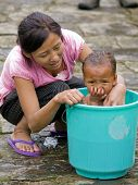 Rabdentse, Sikkim - October 2010: A Young Mother Is Washing Her Daughter in Sikkim, India