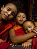 Bhutan - October 2010: Young Buddhist Monks Posing In Front Of The Divine Madman's Fertility Temple