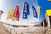 Samara, Russia - March 9, 2014: Ikea Flags Against Sky At Ikea Samara Store. Ikea Is The World's Lar