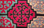 foto of yurt  - Kazak felt carpet with ornament on the wall of the yurt - JPG