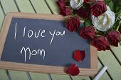 picture of i love you mom  - writing I love you mom on the blackboard and some roses - JPG