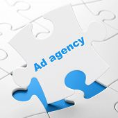 Advertising concept: Ad Agency on puzzle background