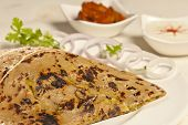image of ghee  - Side View Hot delicious paratha with ghee which is made from wheat flour - JPG