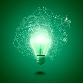Conceptual image of electric bulb against green background