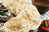 stock photo of urad  - Urad dal puri Indian flatbread which is made with wheat flour served as breakfast dish - JPG