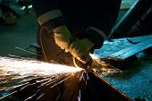 stock photo of welding  - worker welding metal with sparks at factory - JPG