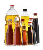Glass bottles of sauces, oil and ketchup