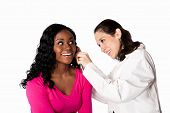 stock photo of otoscope  - Happy smiling doctor physician checking patient ear for infection with otoscope isolated - JPG