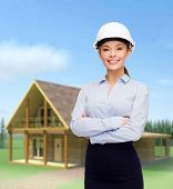 building, developing, consrtuction and architecture concept - friendly young smiling businesswoman i