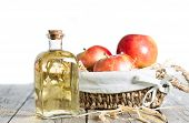 pic of vinegar  - Homemade Vinegar galas apples on a table in a farmhouse
