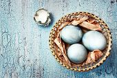 Blue Easter Eggs In A Wattled Plate On A Textured Background. Rustic.