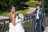 stock photo of fiance  - Bride and fiance on wedding walk outdoors - JPG