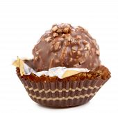 foto of bonbon  - Chocolate gold bonbon with nuts - JPG