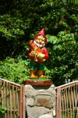 picture of  midget elves  - statuette of the small gnome playing on bagpipe - JPG