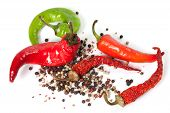 Mix Of Hot Peppers On White Background