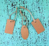 Set of tags on color wooden background