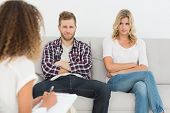 image of not talking  - Unhappy couple not talking on the couch at therapy session - JPG