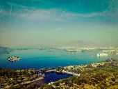Vintage retro hipster style travel image of aerial view of Lake Pichola with Lake Palace (Jag Niwas)
