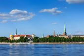 View of Riga over Daugava river: Riga Castle, St. James's Cathedral, St. Peter's Church. Riga, Latvia