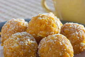 image of laddu  - Laddu or Laddoo is an Indian and Bengali sweet that is often prepared to celebrate festivals or household events such as weddings - JPG