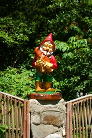 image of  midget elves  - statuette of the small gnome playing on bagpipe - JPG