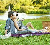 Joyful young couple having fun in park