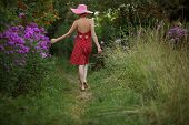 picture of beatitudes  - Woman in a hat walks among the beautiful flowers - JPG