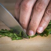 Chef Chopping Parsley Leaves