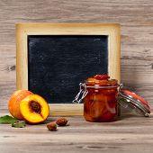 Peach Jam with chalkboard. Selective focus.