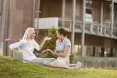Young businesswomen arguing in office lawn