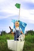 happy boy in hand made ship outdoors play