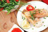 savory fish portion : roasted norwegian salmon chunks with  lemon and vegetable salad , rosemary twi