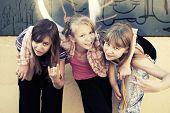 Group of school girls having a fun at the graffiti wall
