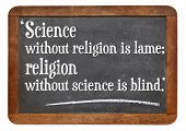 science without religion is lame, religion without science is blind - a quote from Albert Einstein on a vintage slate blackboard