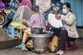 women selling Vietnamese Sandwich with Grilled Pork