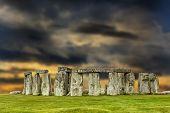 stock photo of stonehenge  - Stonehenge at sunset with apocalyptic sky United Kingdom - JPG