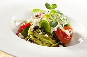 Green Fettucine with Cheese, Tomato, Spinach and Pesto Sauce