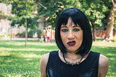 Pretty Goth Girl Posing In A City Park
