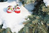 christmas toy cakes on winter tree with snowfall