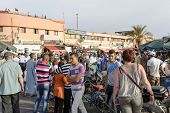 MARRAKESH, MAROCCO - AUGUST 24: Tourists visiting Djemaa el Fna - market place in Marrakesh's medina quarter on 24 August 2014 in Marrakesh, Morocco. Djemaa el Fna is a UNESCO world heritage site.
